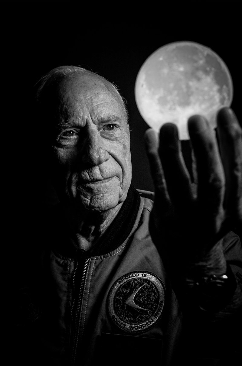 Al Worden holding hand up as if he is holding the moon
